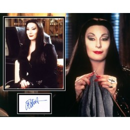 ANGELICA HUSTON SIGNED ADDAMS FAMILY PHOTO MOUNT