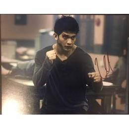 Iko Uwais signed The Raid 14x11  Photo